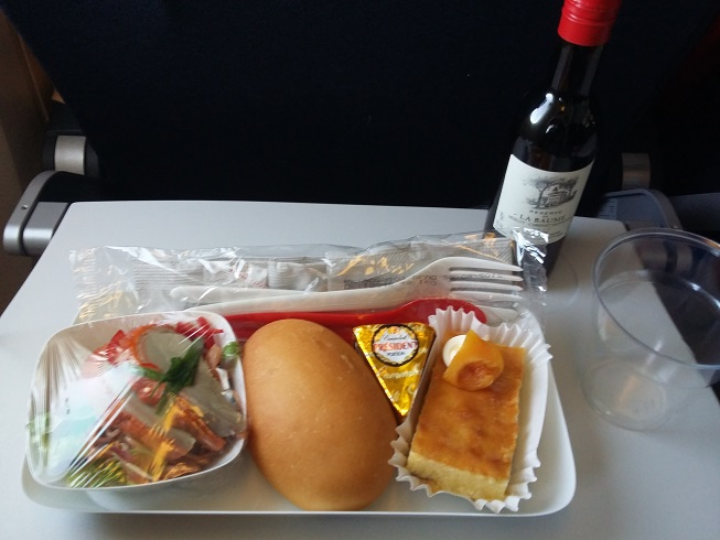 Meal served mid-flight Air France B777 Economy Class- French Cuisine with Choice of Wine